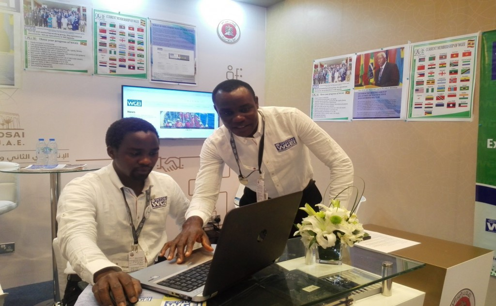 WGEI-CoP staff at the WGEI booth in Abu Dhabi